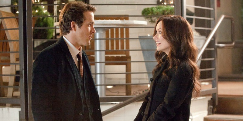 Ryan Reynolds and Olivia Wilde talking to each other in The Change-Up
