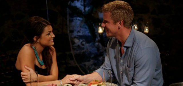 Sean Lowe smiles and holds Tierra LiCausi's hand across a small table.