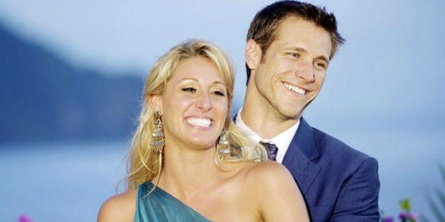 Vienna Girardi and Jake Pavelka smiling as they pose together in front of an ocean.