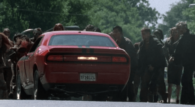 A Camaro is surrounded by zombies in 'The Walking Dead'