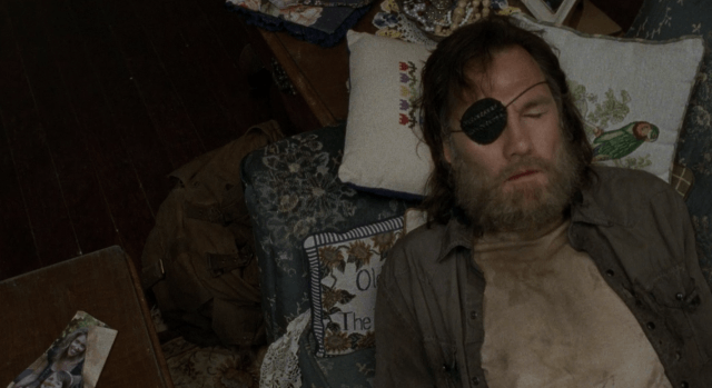 The Governor lays on a couch in a scene from 'The Walking Dead'
