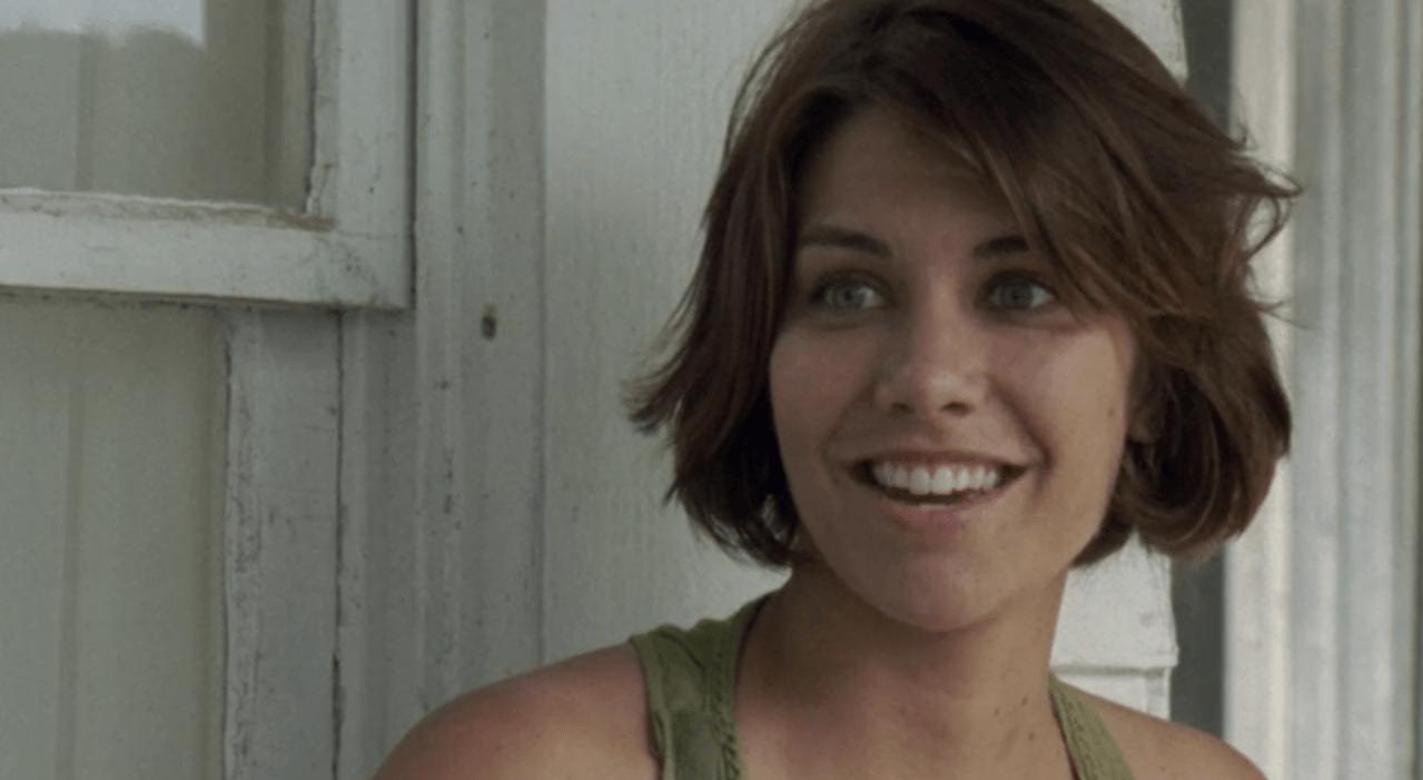 Maggie is smiling in The Walking Dead.