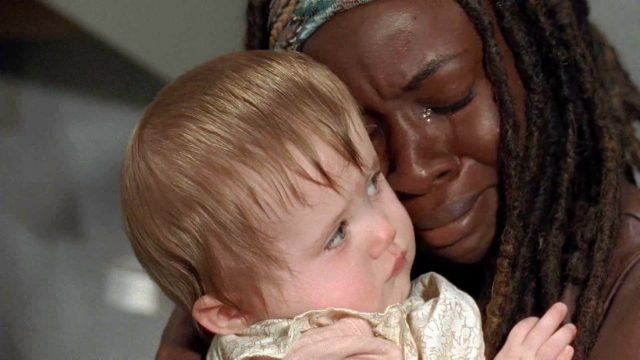Michonne cries as she holds Judith in a scene from 'The Walking Dead' episode 'Infected'
