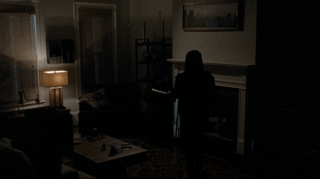 Michonne holding her katana in her living room in 'The Walking Dead' episode 'Conquer'