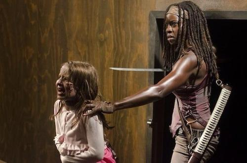 Michonne holds a zombified Penny in 'The Walking Dead' episode 'Made to Suffer'