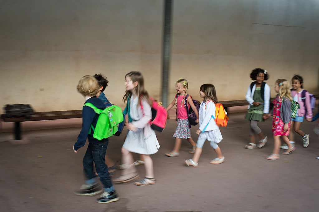 Pupils walk to their classroom