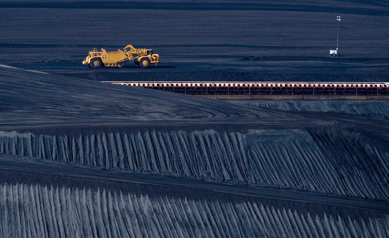 A coal scraper machine works on a pile of coal in West Virginia