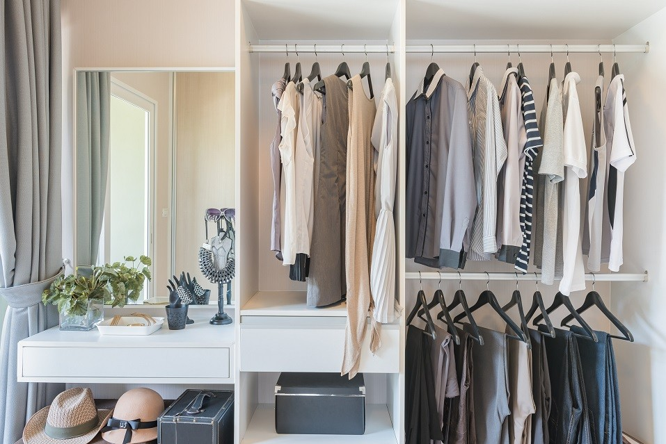 white wardrobe with shirts and pants