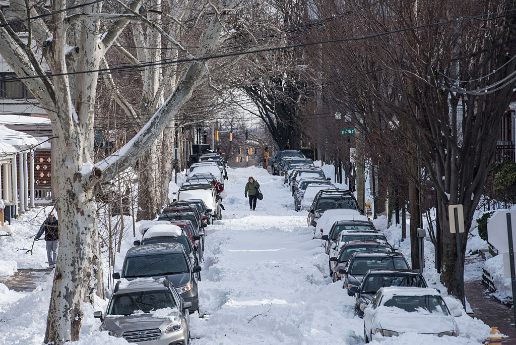 Cars buried in snow.