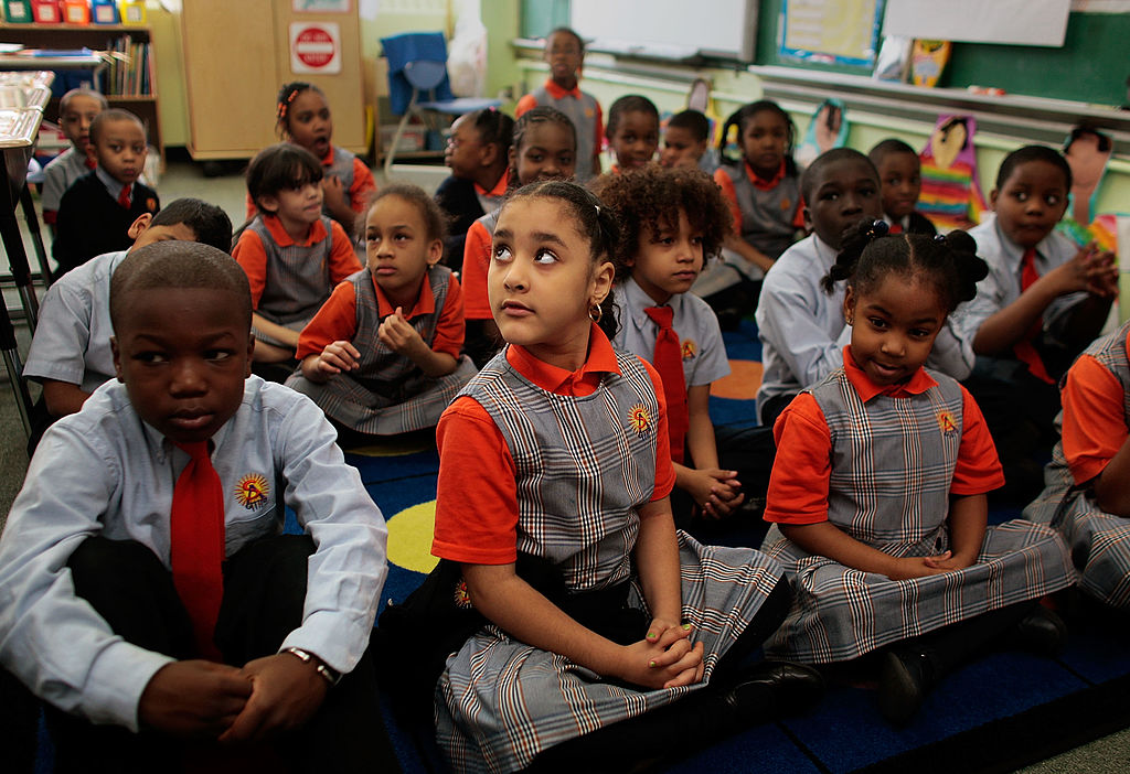 Students sit quietly and wait for their teacher