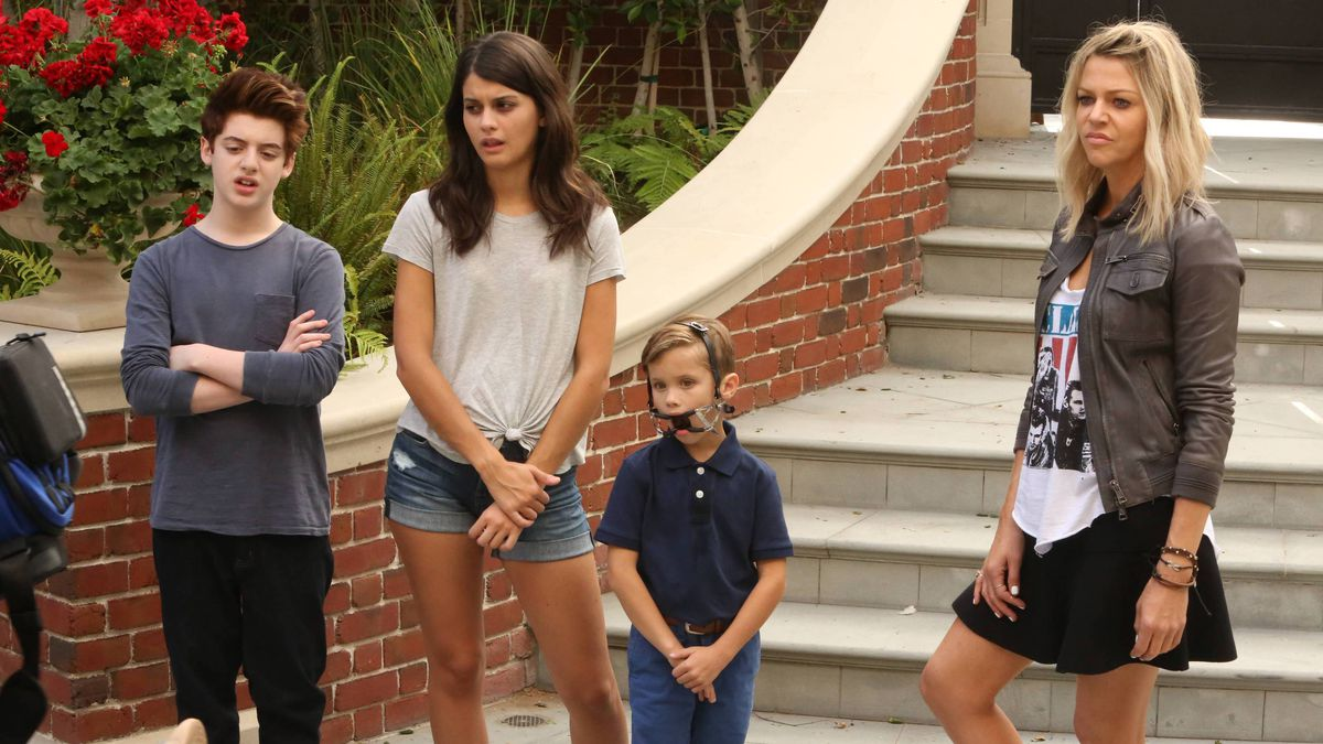The cast of Fox's comedy The Mick stands at the bottom of the stairs
