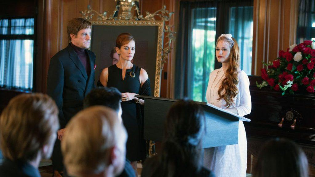 The Blossom family stands in front of a Jason Blossom's casket in The CW's Riverdale
