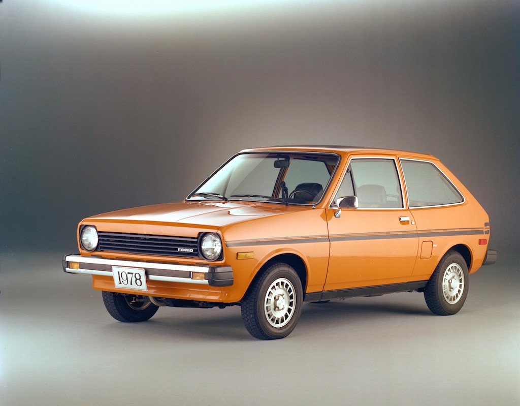 An orange 1978 Ford Fiesta on display.