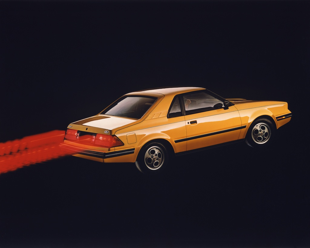 A vintage advertisement for the 1982 Ford EXP