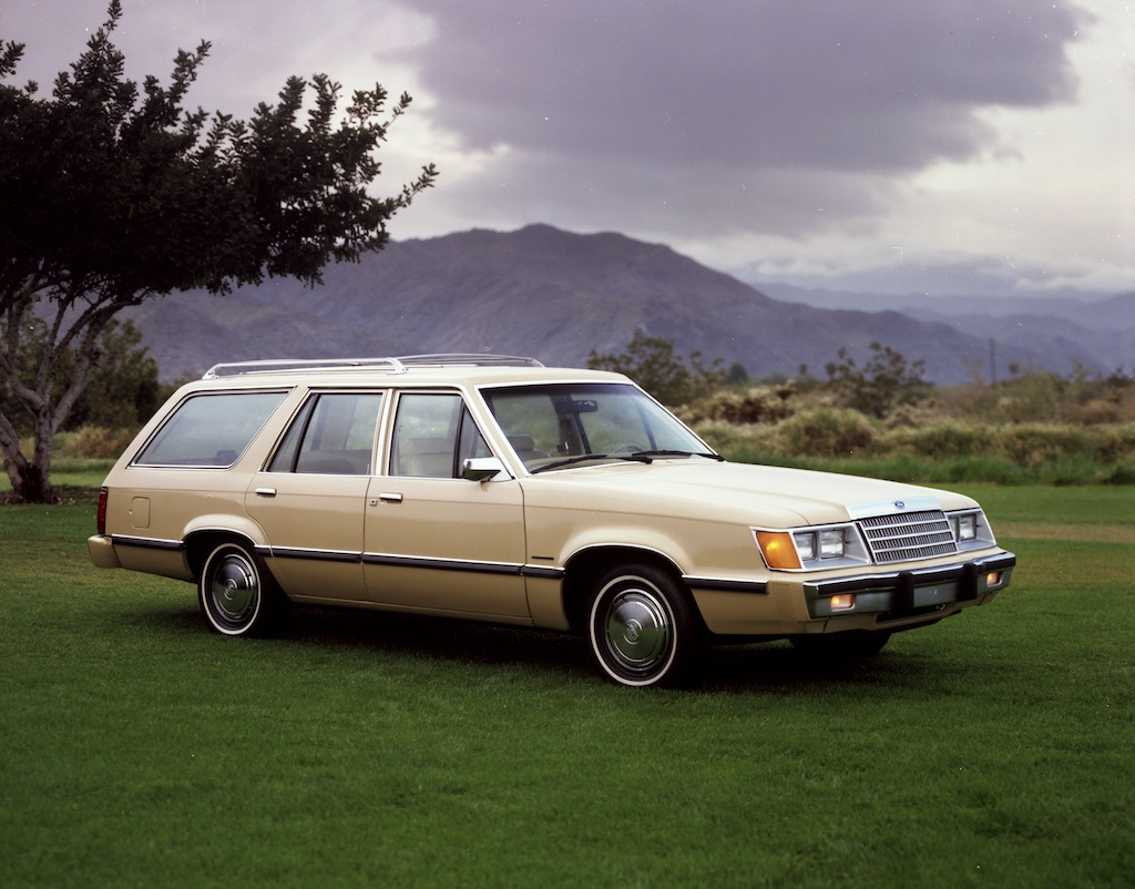 A 1983 Ford LTD Station wagon parked on grass.
