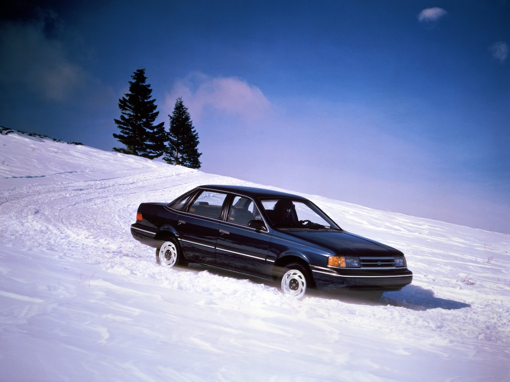 A 1989 Ford Tempo AWD being driven through snow.