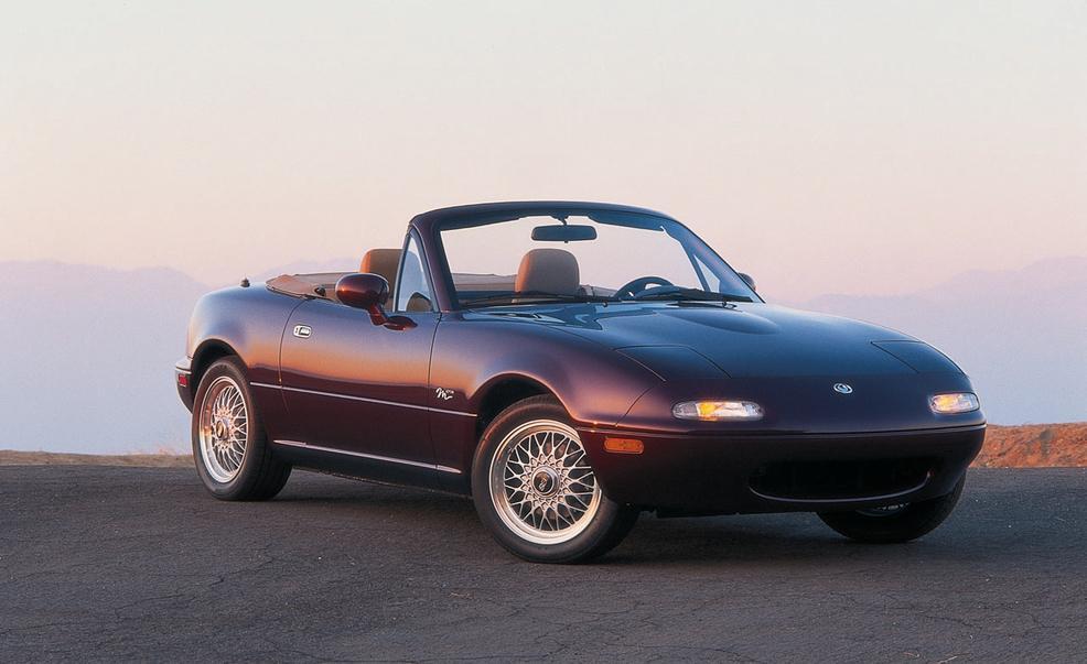 iew of 1995 MX-5 Miata M edition in merlot mica on California coast