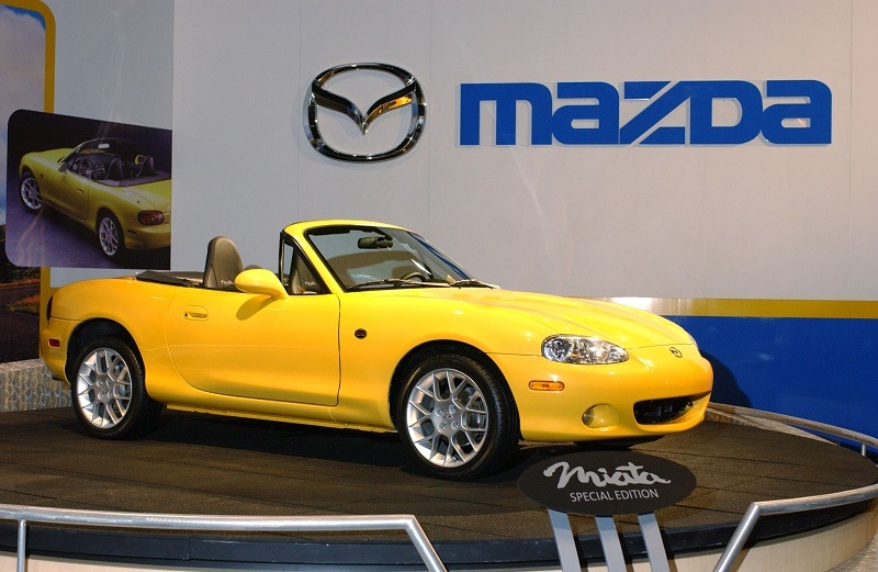 Miata 2002 special edition in blazing yellow mica at Chicago Auto Show