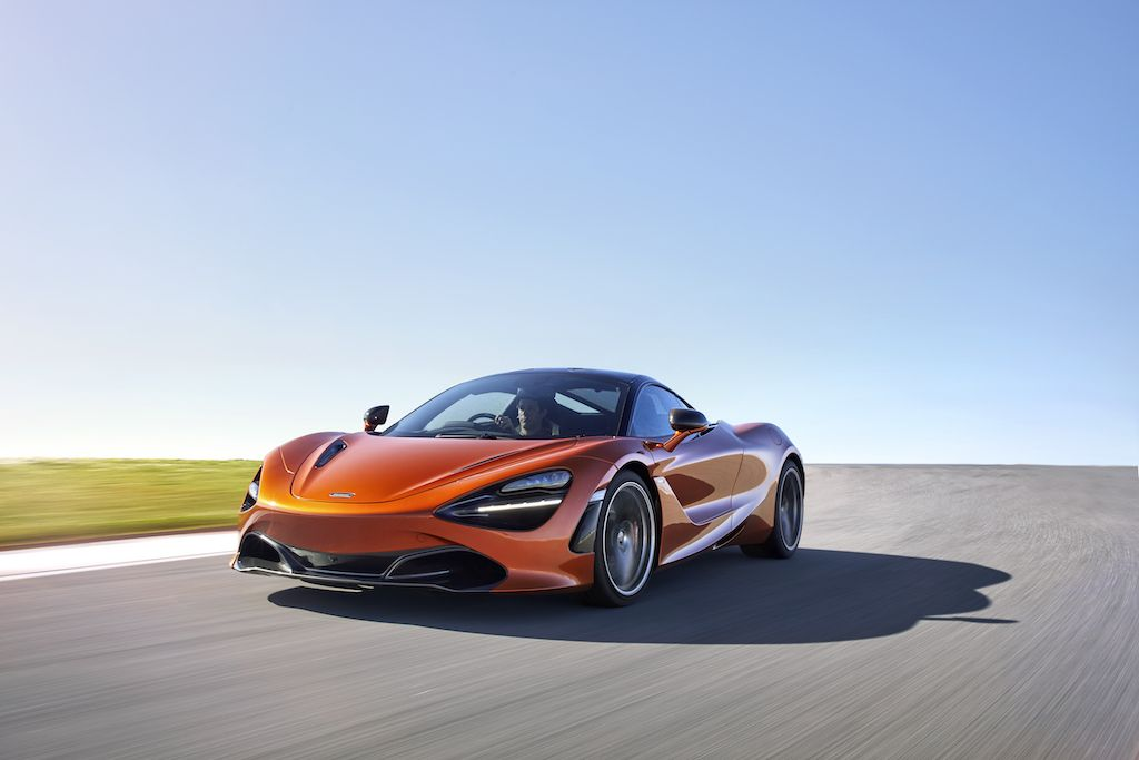 2018 McLaren 720S Super Series speeding down a road.