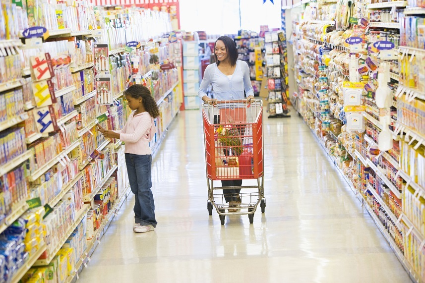 Mother and daughter shopping for groceries