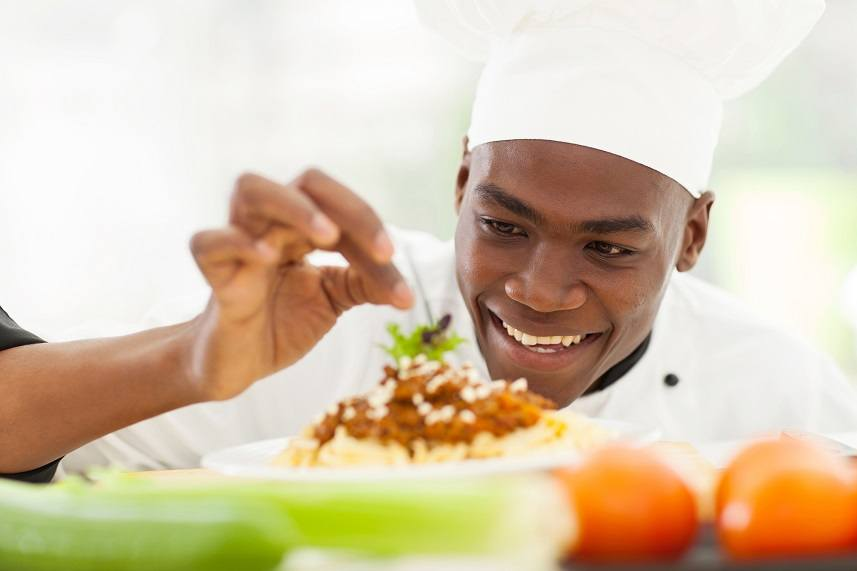 Afro American chef in restaurant kitchen