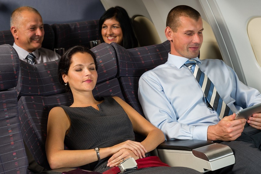 Airplane passengers relax during flight