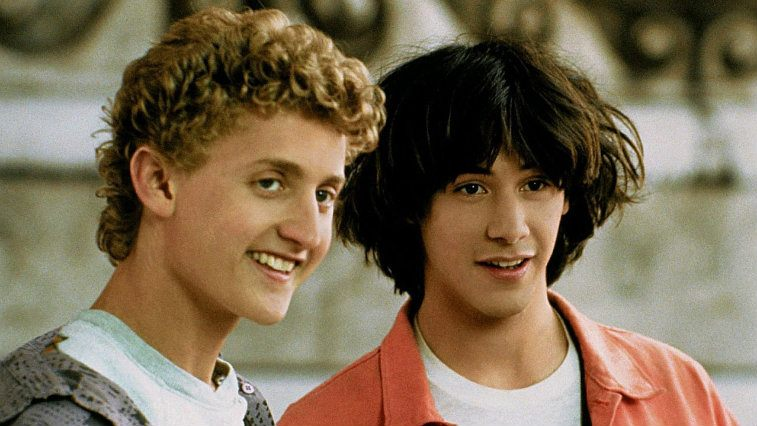 Alex Winter and Keanu Reeves smiling together in Bill and Ted's Excellent Adventure