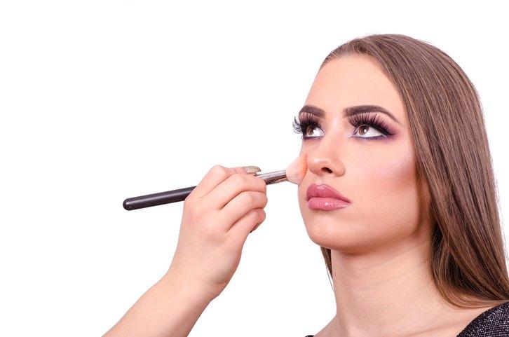young woman having makeup and facial contouring