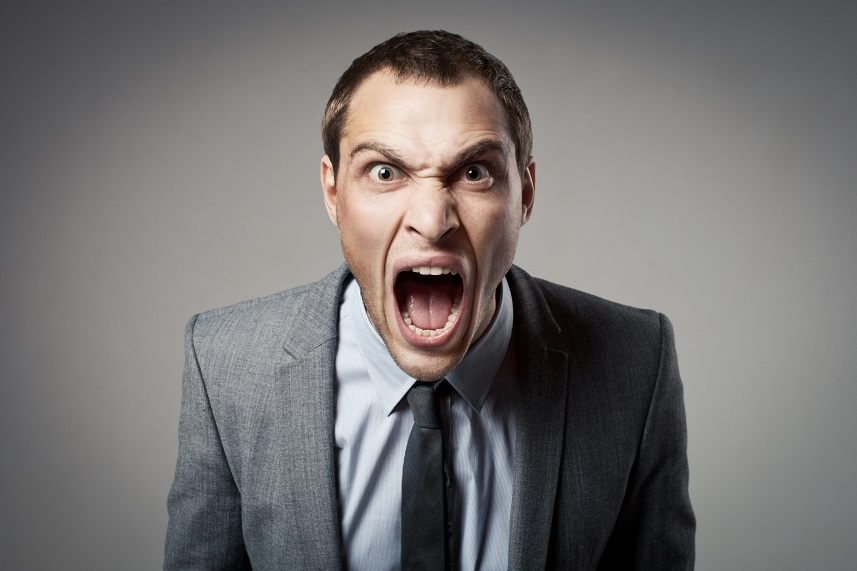 Businessman shouting and looking angry