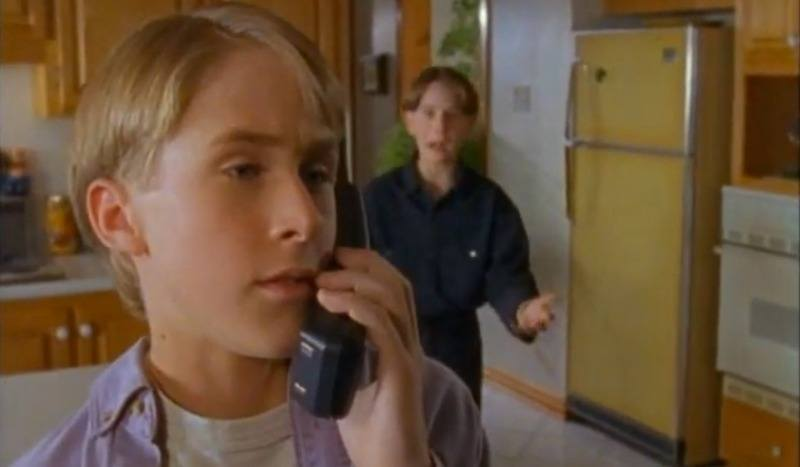 Ryan Gosling talking on the phone in a kitchen in Are You Afraid of the Dark?