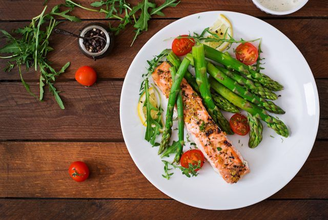 fresh produce with salmon on a plate