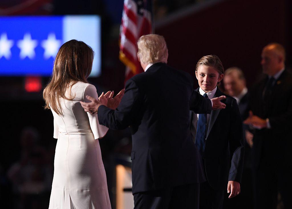 Donald Trump and his wife Melania Trump greet their son Barron Trump