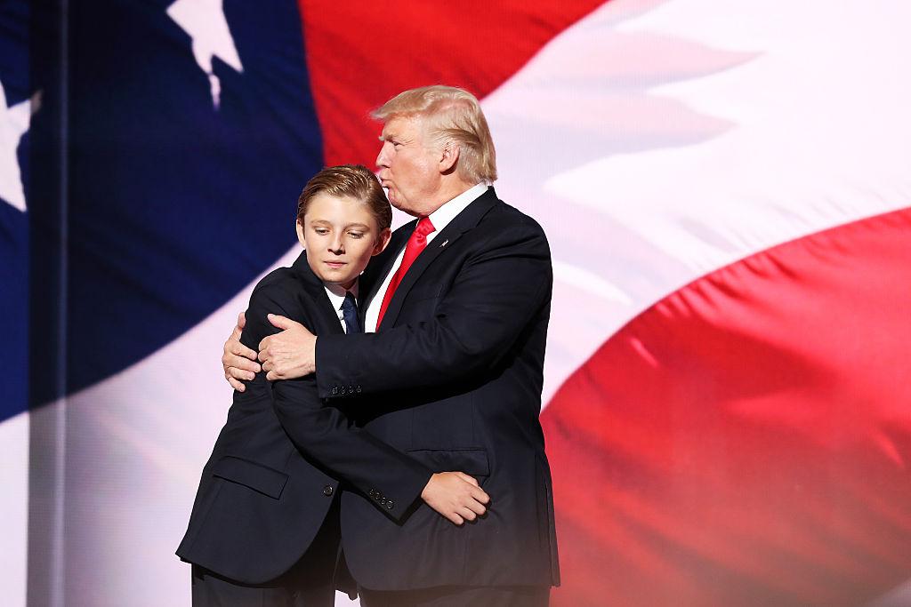 Barron Trump receives a hug from his father, Donald Trump.