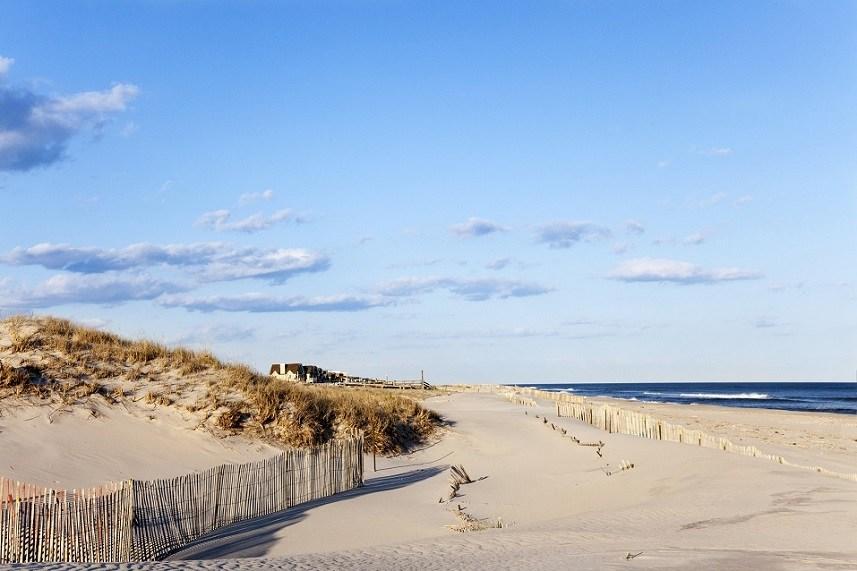 Beach fence, sand houses and the ocean