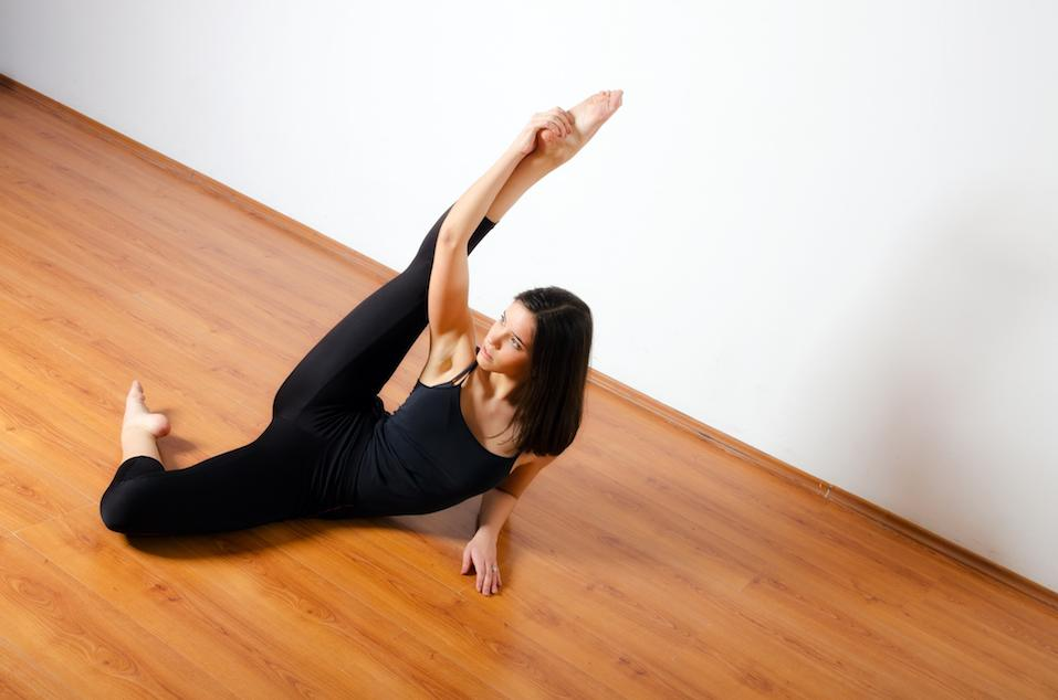 ballerina stretching on the floor