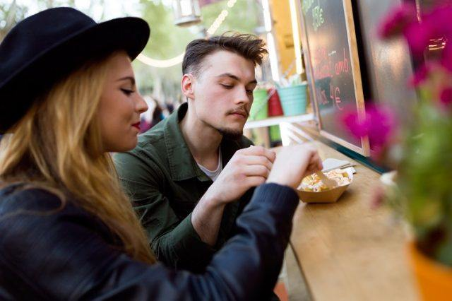 young couple visiting eat market