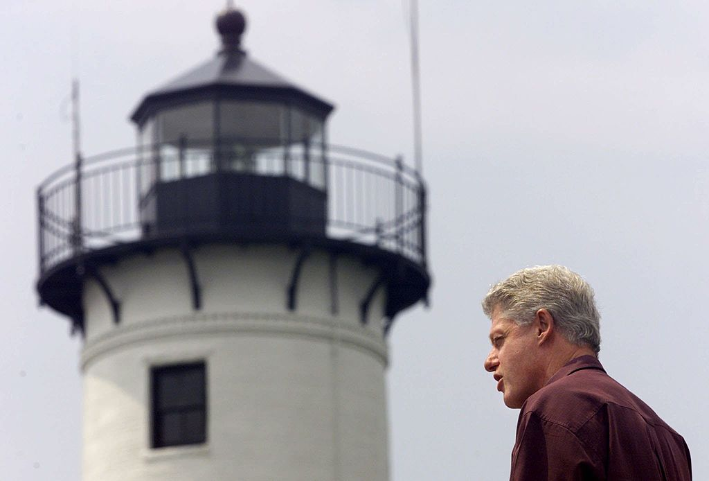 President Bill Clinton stands by a lighthouse