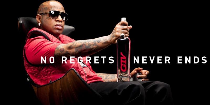 Birdman sitting with a bottle of GTV