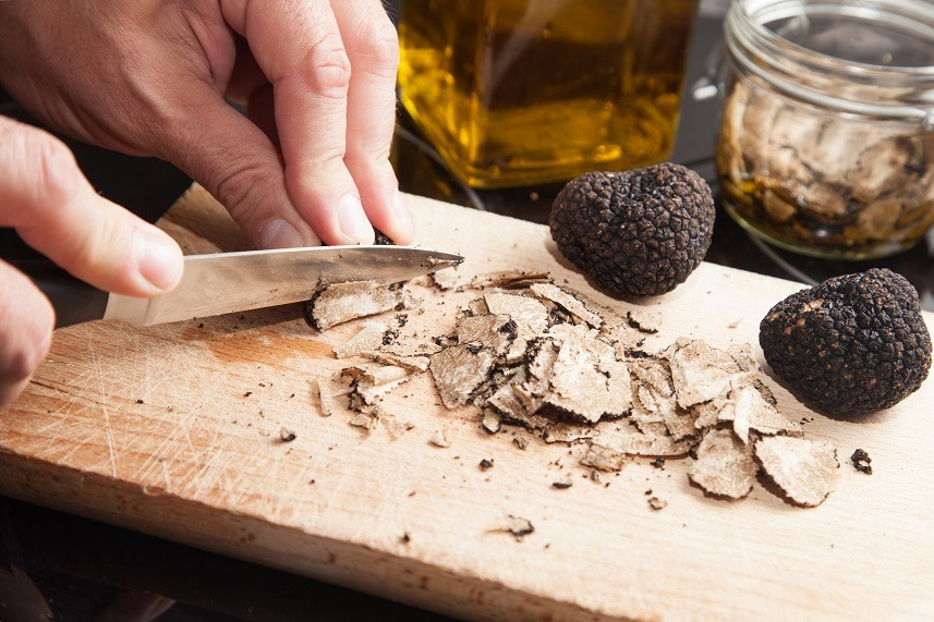 Hands cutting truffel