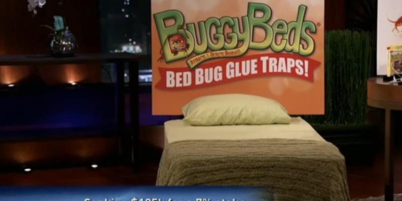 "A bed display with a sign reading ""BuddyBeds"" on Shark Tank."