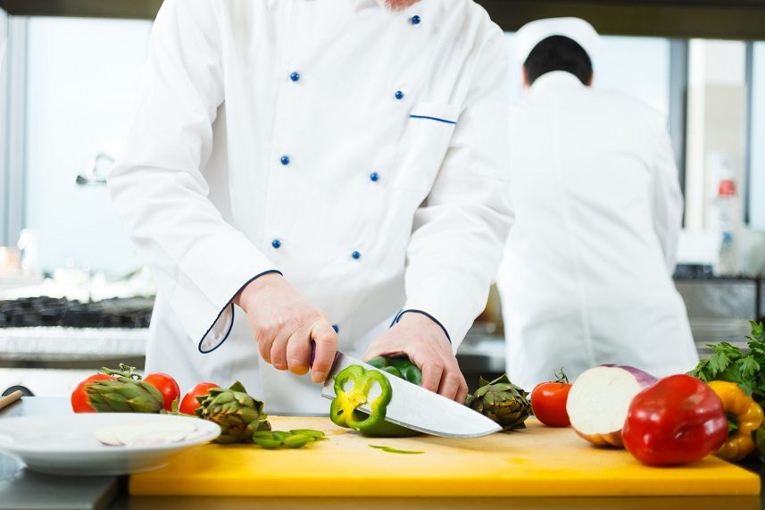Friendly chef preparing vegetables