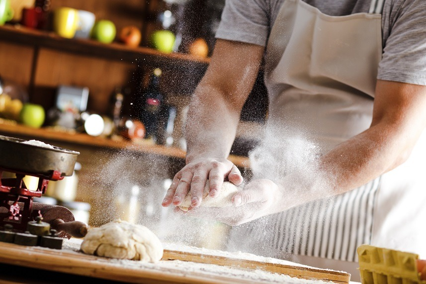A baker prepares bread.
