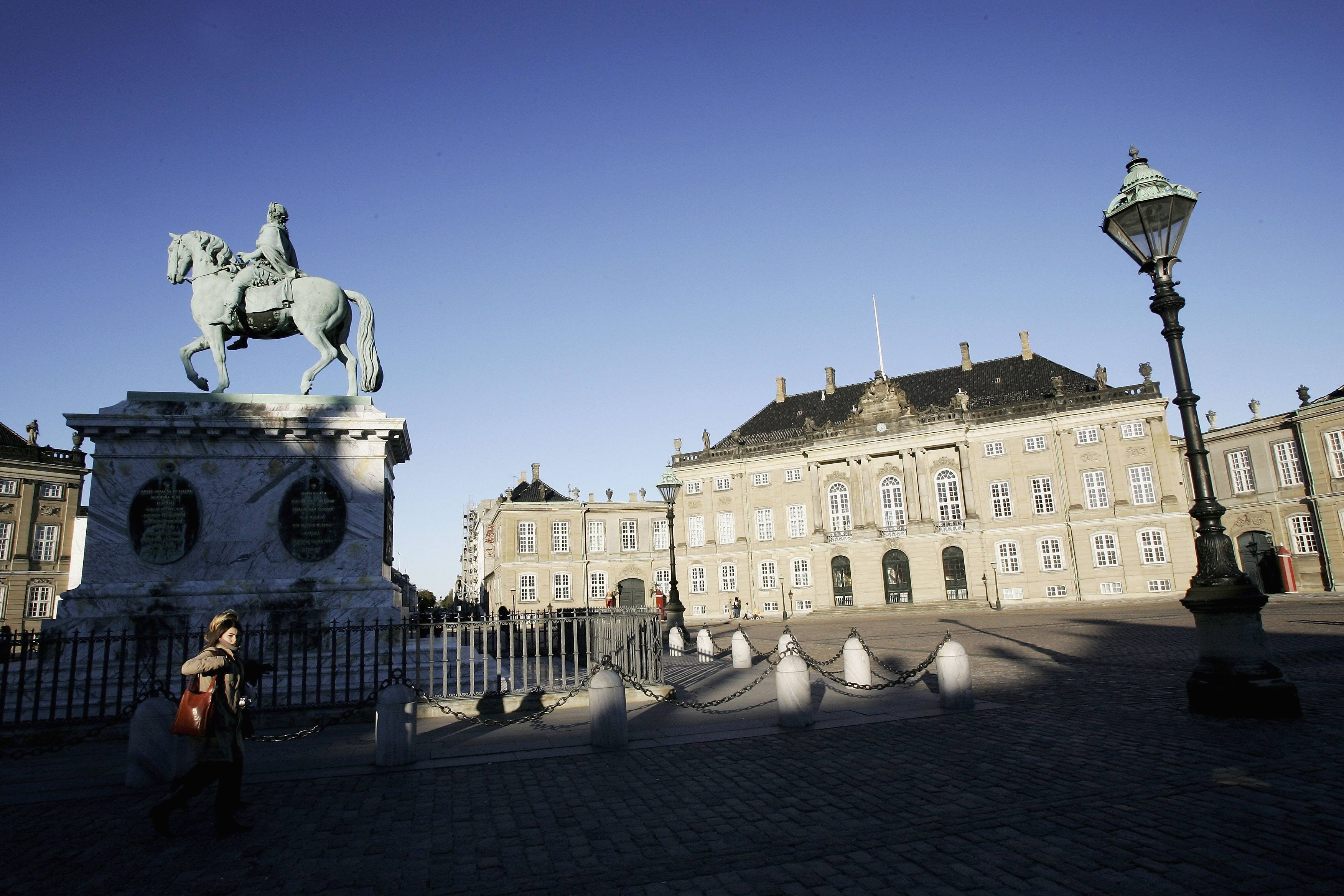 A statue of Fredrick V on Horseback is seen in the center of the Amalienborg Slot, home of the Danish Royal family
