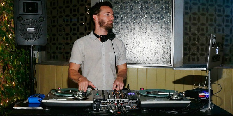 Danny Masterson is working at a DJ turntable