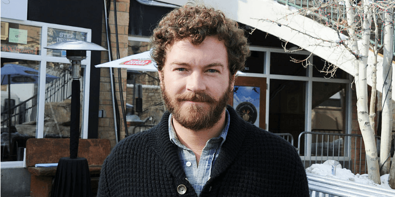 Danny Masterson is in front of Stella Artois Lounge.