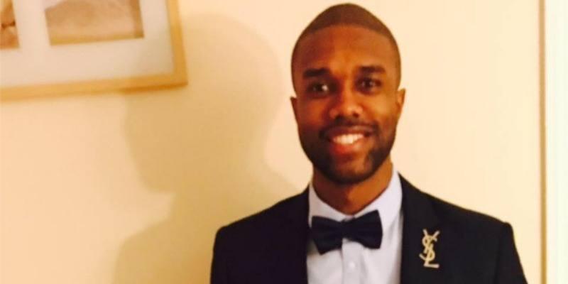 Demario Jackson in a suit and tie.