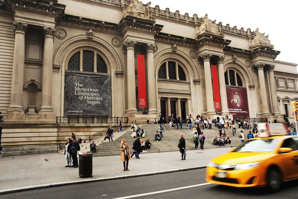 People congregate at the entrance to the Metropolitan Museum