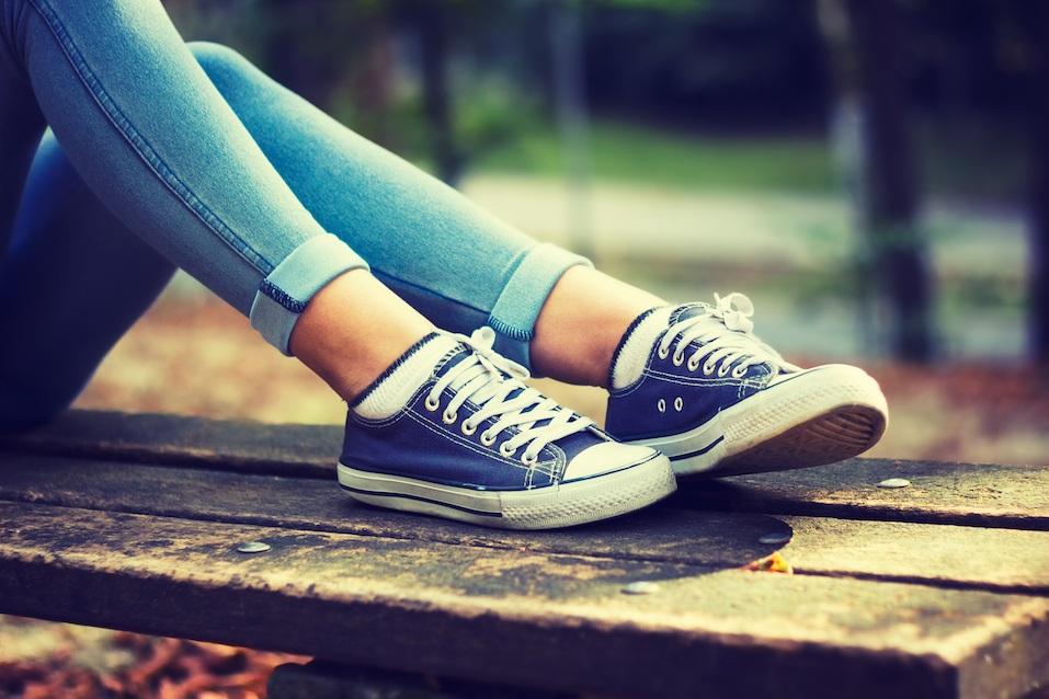 woman in blue sneakers