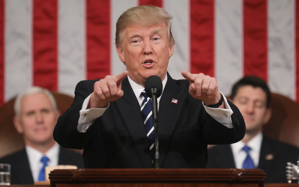 U.S. President Donald J. Trump (C) delivers his first address to a joint session of the U.S. Congress