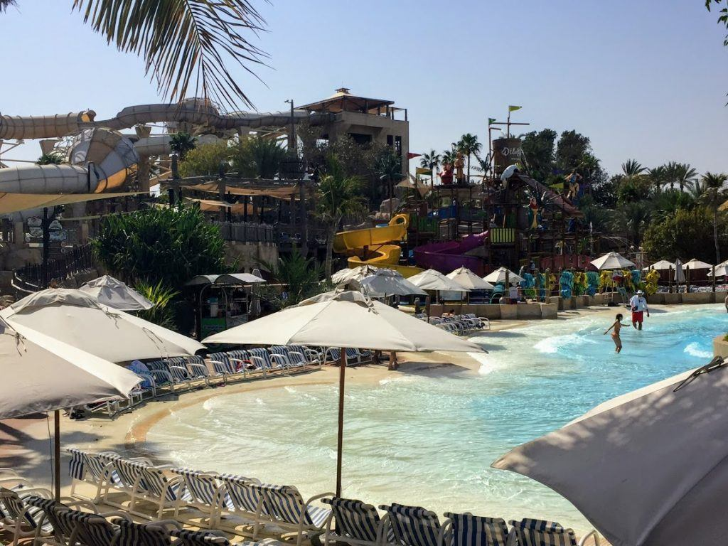 hotel waterpark with beach area, watersliders, and a splash park